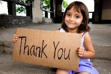 small girl holding a thank you